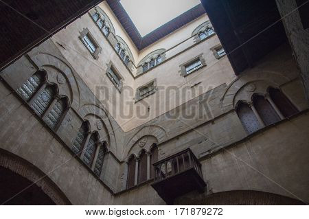 Italy Pistoia - November 27 2016: the view of the wall of inner courtyard of the Palazzo del Comune. Municipal Museum of Pistoia on November 27 2016 in Pistoia Tuscany Italy.