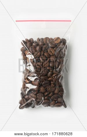 Plastic Transparent Zipper Bag With Full Wholegrain Coffee Beans Isolated On White, Vacuum Package M