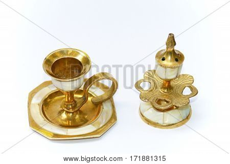 The picture shows the brass candlestick inlaid with mother of pearl.