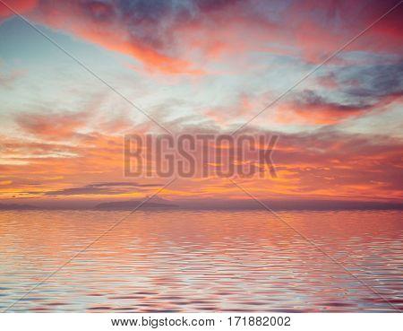 Majestic pink - orange sunset over the sea.