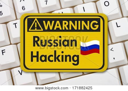 Russian hacking warning sign A yellow warning sign with text Russian hacking on a keyboard 3D Illustration
