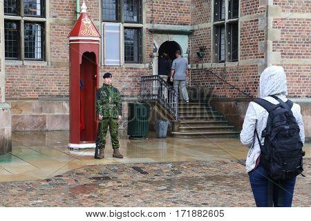 COPENHAGEN, DENMARK - JUNE 29, 2016: This is an armed guard near Rosenborg Castle where the Crown Jewels are kept.