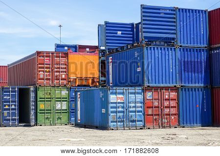 Labuan,Malaysia-July 21,2016:Row of containers ready to be transported onto a ship in a container terminal in the Port of Labuan,Malaysia on 21st July 2016