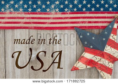Made in America message USA patriotic old flag and a star and weathered wood background with text Made in the USA