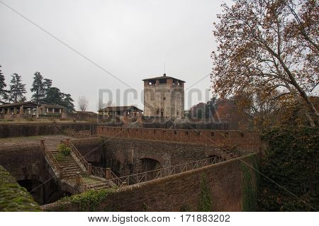 Italy Pistoia - November 27 2016: the view of medieval tower and walls of Medici Fortress of Santa Barbara on November 27 2016 in Pistoia Tuscany Italy.