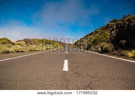 Road over clouds on Teide mountains in Tenerife Canary Islands Spain