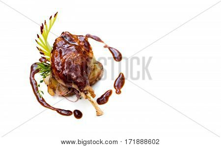 Duck pestle confit with potato. Roasted poltry meat leg seasoned garlic bacon sauce. White background Up view, copy space