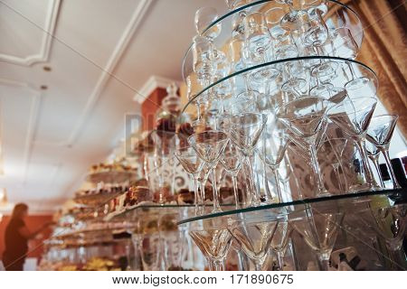 stack of wine glasses. luxury decorated tables in the wedding hall