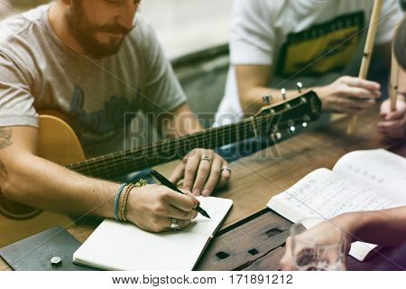 Group of friends playing guitar and singing together