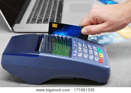 Hand using bank terminal for credit card payment