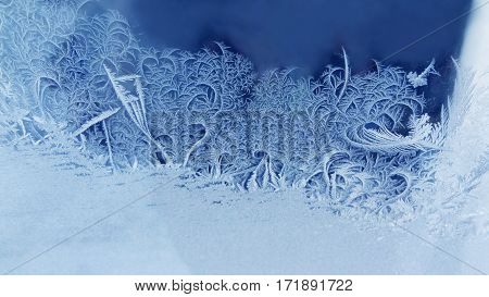Ice flowers frozen window background. macro view photography frost textured pattern. cold winter weather xmas concept. shallow depth field