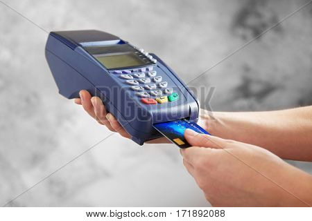 Hands using bank terminal for credit card payment
