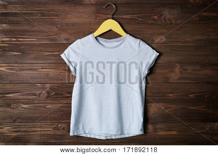 Blank color t-shirt against wooden background