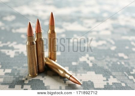 Bullets on camouflage background
