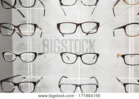 Showcase with spectacles in modern ophthalmic store