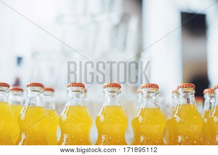 bottle of Orange Fanta glass soda. Buffet table