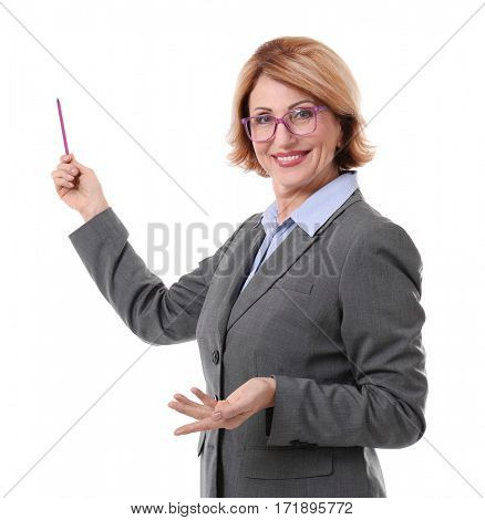Middle-aged teacher pointing at something isolated on white