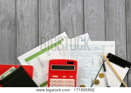 Calculator and money on individual income tax return forms