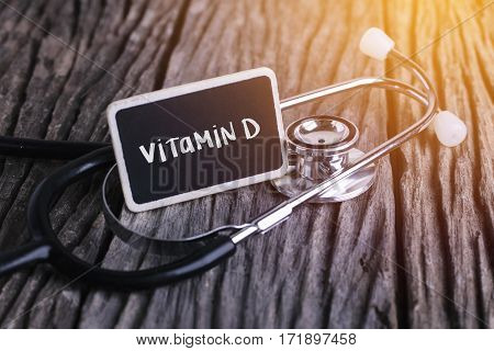 Medicine Concept. Blackboard With Word Vitamin D On Wooden Background.