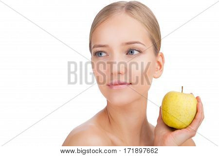 Beauty Woman face Portrait with apple. Beautiful Blonde Spa model Girl with Perfect Fresh Clean Skin. Skin Care Concept Isolated on a white background