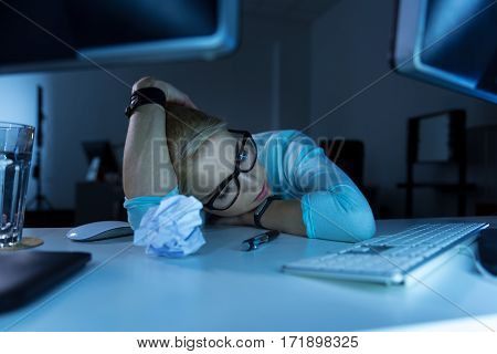 Tired from everything . Upset sleepy tired programming specialist sitting in the office while feeling tired and falling asleep