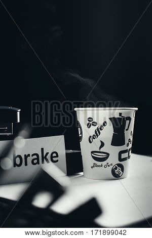the black background of the inscription a break for coffee paper Cup