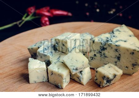 Blue cheese on wooden board. Tasty appetizer. Selective focus.