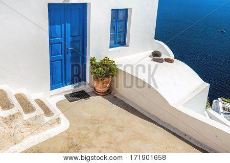 Blue door with blue window, blue sea and blue sky on Santorini island, Greece.