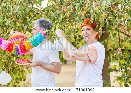 Seniors decorating for a summer party in the park