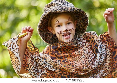 Boy having fun in children's theater dressed up like leopard