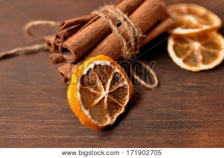 The tubes of cinnamon and dried lemon.