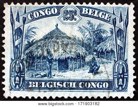 BELGIAN CONGO - CIRCA 1932: a stamp printed in Belgian Congo shows Uele hut circa 1932