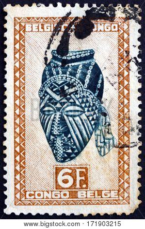 BELGIAN CONGO - CIRCA 1948: a stamp printed in Belgian Congo shows Ngadimuashi female mask Baluba tribe circa 1948