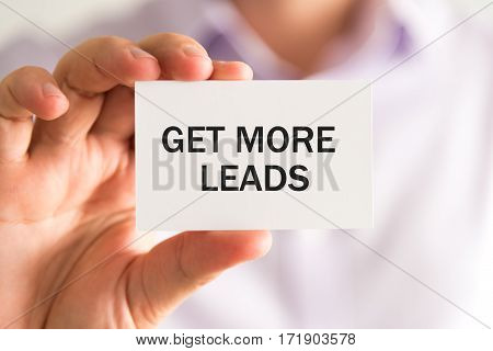 Businessman Holding Get More Leads Text Card