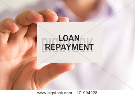 Businessman Holding Card With Text Loan Repayment
