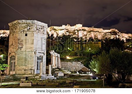 Roman agora in Athens, Greece. Tower of the Winds. Photo at nighttime.