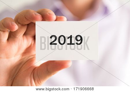 Businessman Holding A Card With Text Year 2019