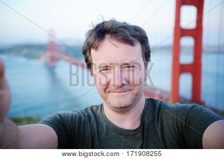 Man Making A Selfie With Famous Golden Gate Bridge