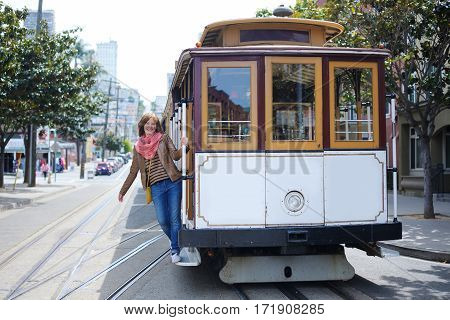 Tourist Taking A Ride In Cable Car In San Francisco, California,