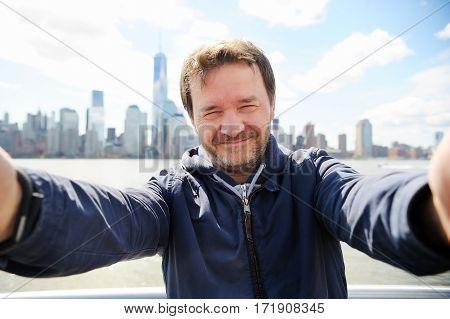 Man Making Selfie With Manhattan Skyscrapers In New York City