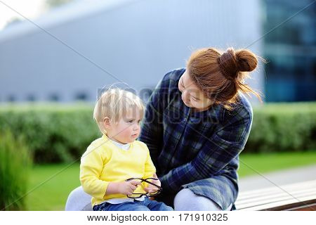 Young Loving Asian Woman With Cute Caucasian Toddler Boy