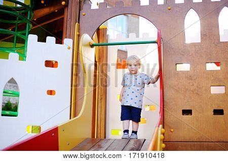 Cute Toddler Boy On Playground. Active Game For Little Kids