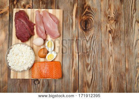 sport fitness healthy lifestyle diet and people concept - close up of natural protein food and additive on wooden table