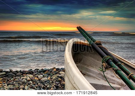 Row boat at Playa Waikiki in Lima Peru on a cloudy colorful sunset