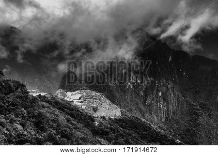 Machu Picchu, lost city of the Incas, designated Peruvian Historical Sanctuary in 1981 and UNESCO World Heritage Site in 1983 and one of the New Seven Wonders of the World - in black and white