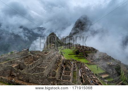 Rain and fog at Machu Picchu lost city of the Incas designated Peruvian Historical Sanctuary in 1981 and UNESCO World Heritage Site in 1983 and one of the New Seven Wonders of the World