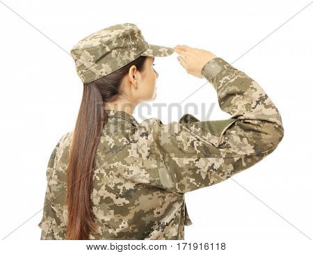 Pretty female soldier saluting on white background