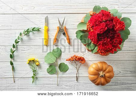 Necessary thing for making beautiful pumpkin composition on white wooden table