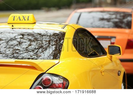 Closeup of yellow taxi cab in traffic jam