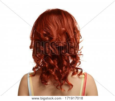 Beautiful young woman with dyed curly hair on white background